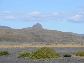 Rock pillars like the one seen in the distance are a sources for many Icelandic folk tales, usually ones about roving night trolls fossilised by the rising sun. This one is can be seen from the road into Þórsmörk.