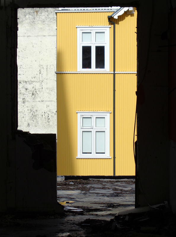 Yellow house, framed