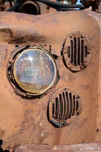 Headlights of a rusty old car