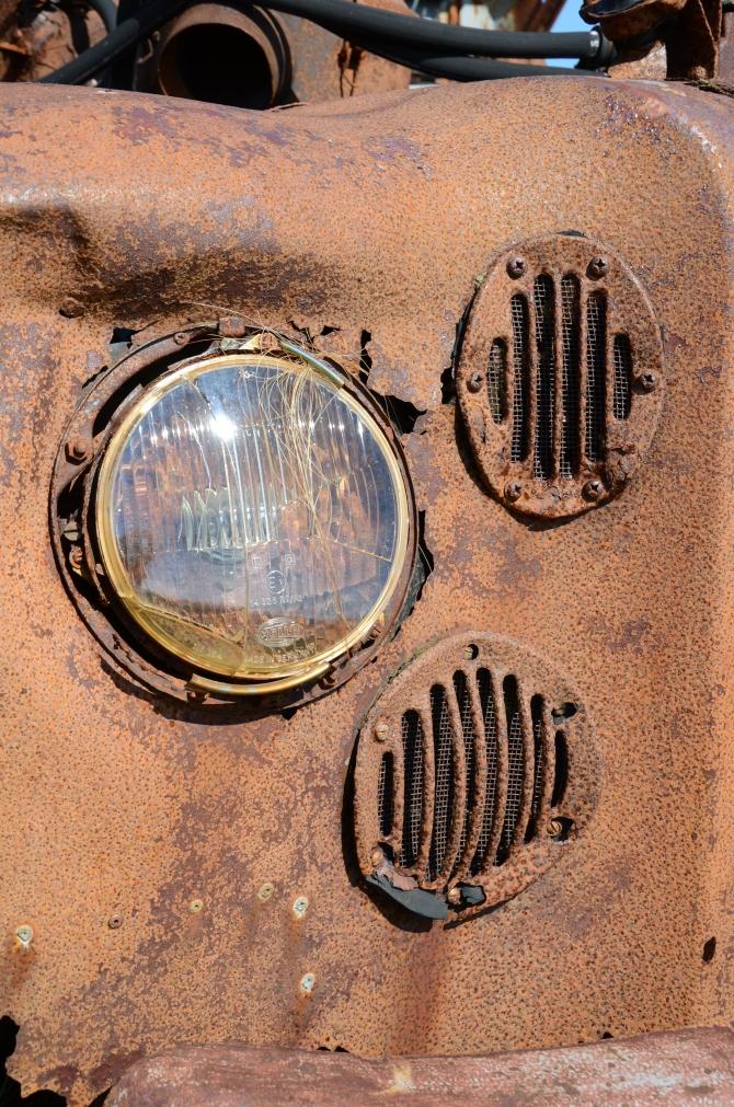 Headlights of a rusty old car