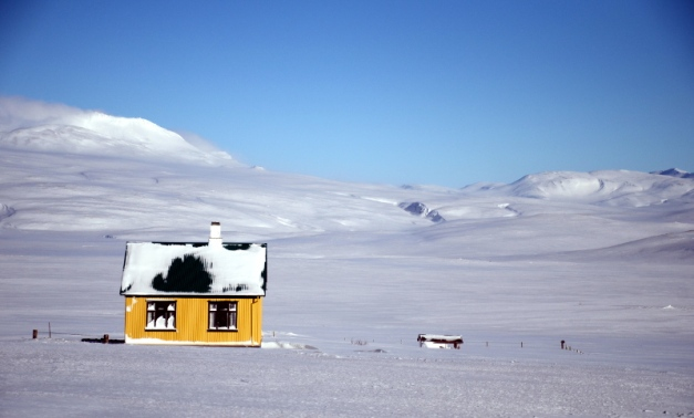 Little yellow house in the snow